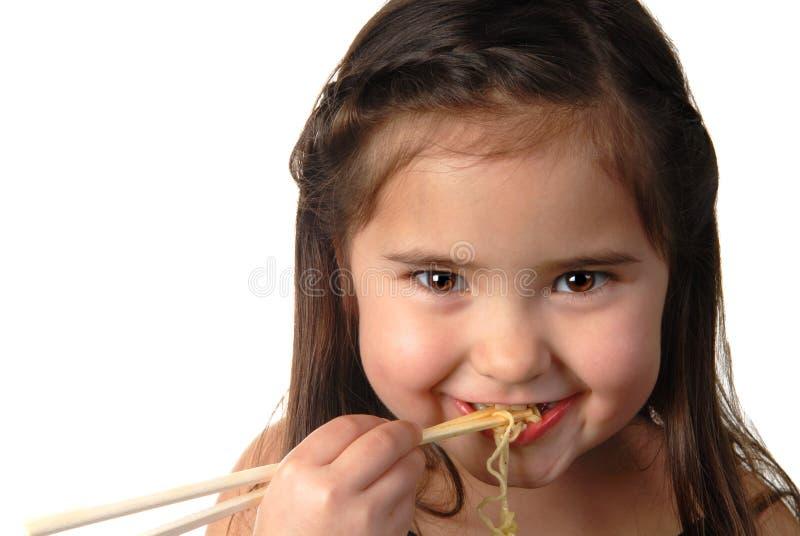Rapariga que come a sopa de macarronete imagens de stock royalty free