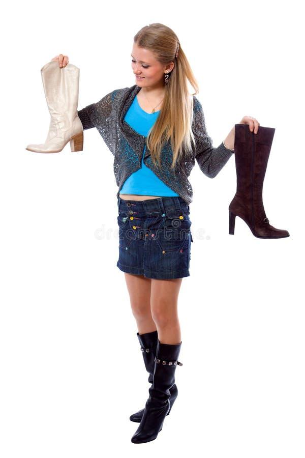 Rapariga que escolhe o carregador novo imagens de stock royalty free
