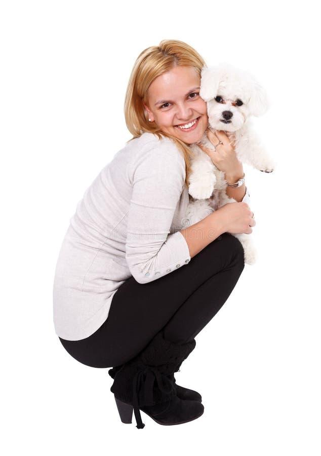 Rapariga que guardara o filhote de cachorro fotos de stock royalty free