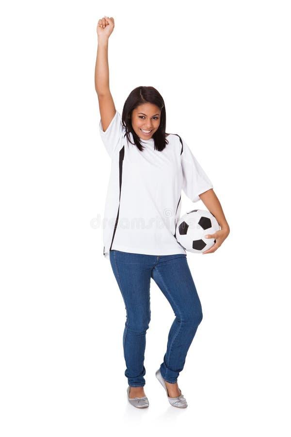 Rapariga que guardara o futebol fotografia de stock royalty free