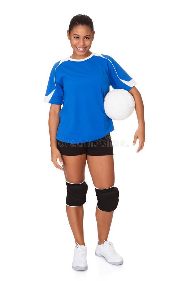 Rapariga que guardara o voleibol imagens de stock royalty free