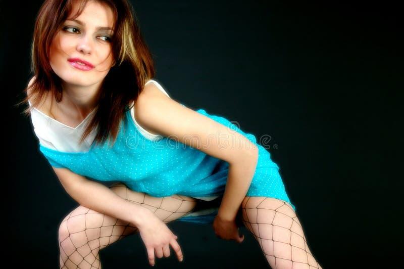 Rapariga que inclina-se para a frente imagens de stock royalty free
