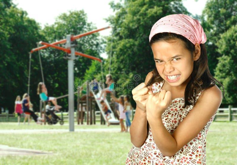 Rapariga que mostra seu punho foto de stock royalty free