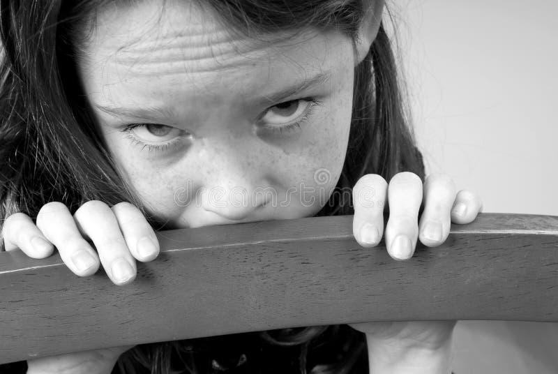 Rapariga que olha triste fotografia de stock royalty free