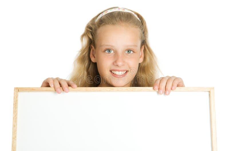 Rapariga que prende uma bandeira branca foto de stock royalty free