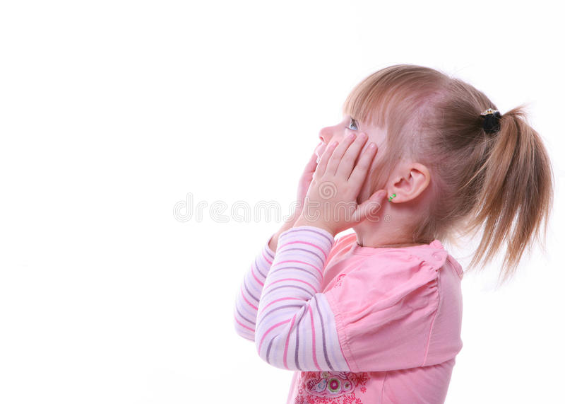 Rapariga surpreendida isolada que olha acima fotografia de stock royalty free