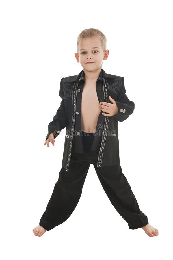 Rapaz pequeno adorável que finge ser um rockstar imagem de stock royalty free