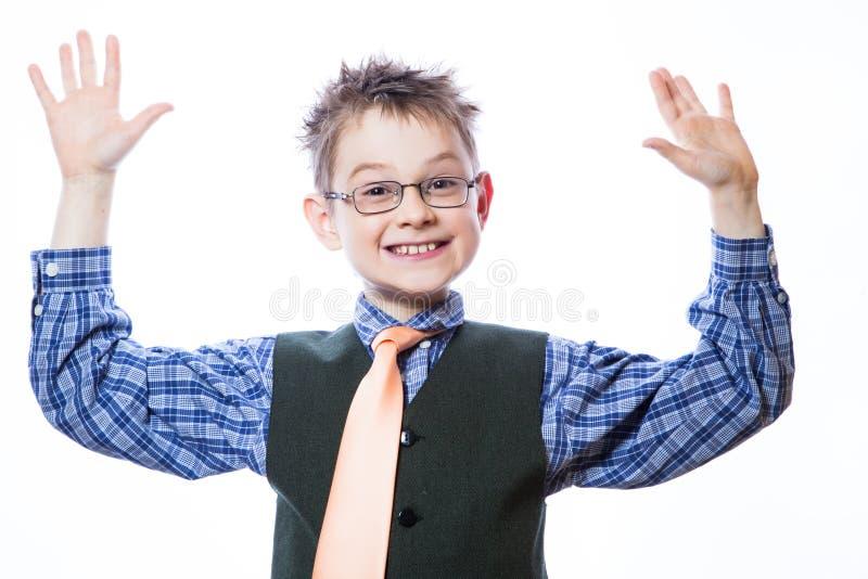 Rapaz pequeno com cara engraçada fotografia de stock royalty free