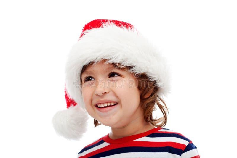 Rapaz pequeno com o chapéu de Santa na cabeça imagens de stock royalty free