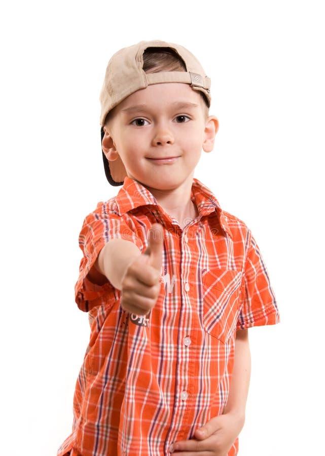 Rapaz pequeno com seu polegar acima imagens de stock