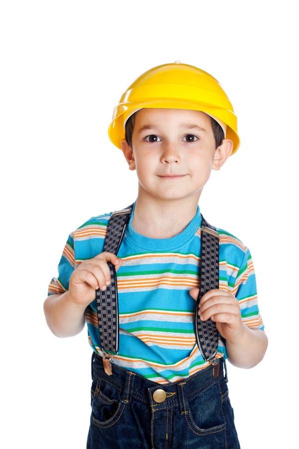 Rapaz pequeno com um capacete do edifício foto de stock royalty free