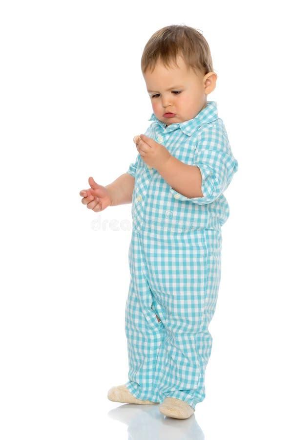 Rapaz pequeno curioso fotografia de stock royalty free