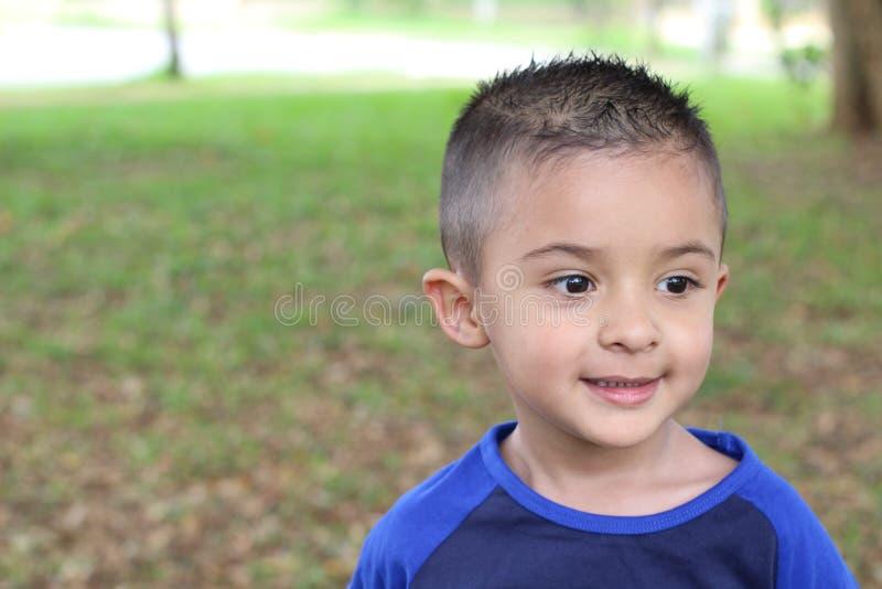 Rapaz pequeno latino com espaço da cópia fotografia de stock royalty free