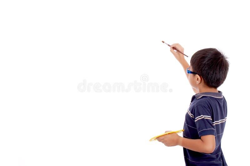 Rapaz pequeno na vista traseira fotos de stock
