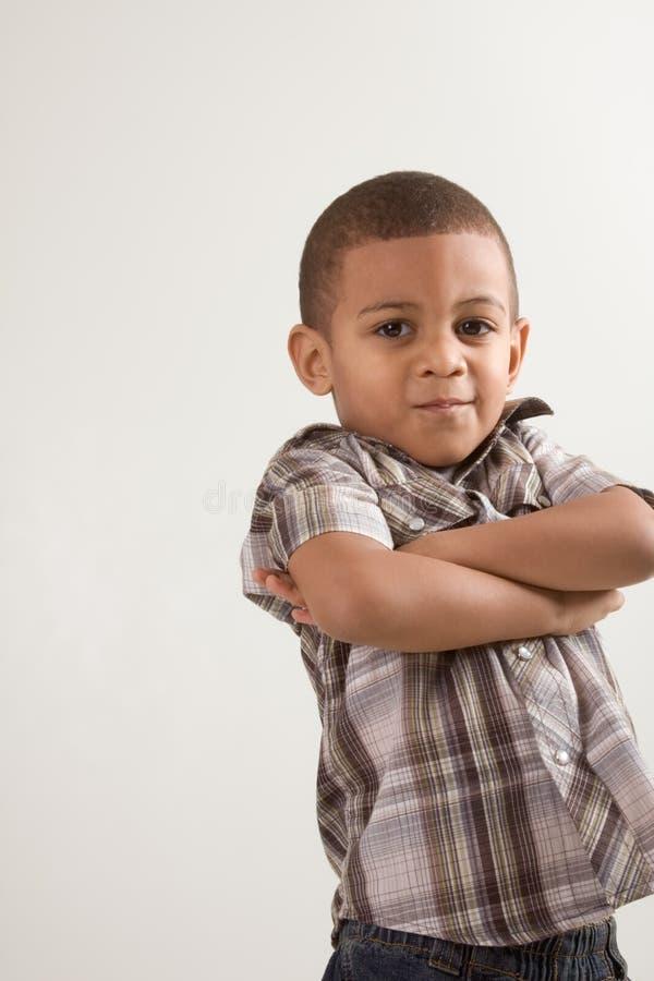 Rapaz pequeno novo em camisa e em calças de brim checkered foto de stock royalty free