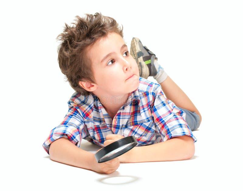Rapaz pequeno pensativo com cabelo estranho fotografia de stock royalty free