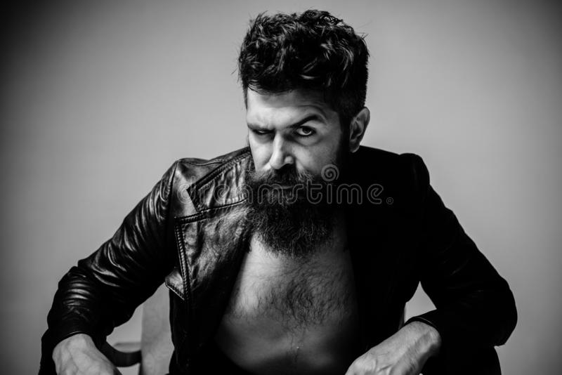 Rape and Sexual abuse concept. Portrait of brutal handsome bearded man. Stylish man looking away. Men fashion portrait royalty free stock photography