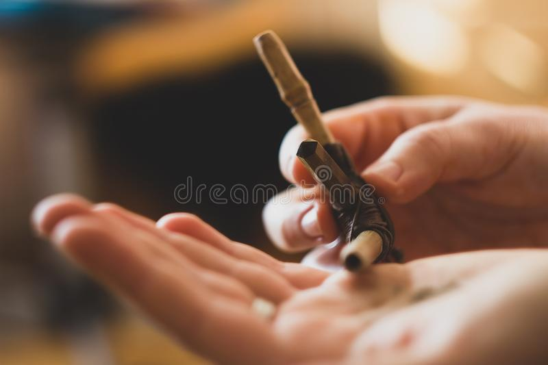 Rapee ceremony. Healing herbs and dust preparing to snuff. By tepi bamboo handmade pipe royalty free stock images
