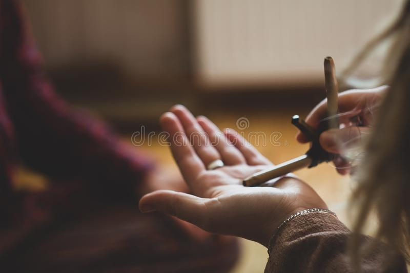 Rapee ceremony. Healing herbs and dust preparing to snuff. By tepi bamboo handmade pipe royalty free stock photography