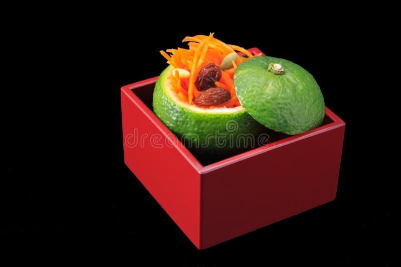 Rapee de la zanahoria en taza verde del yuzu imágenes de archivo libres de regalías