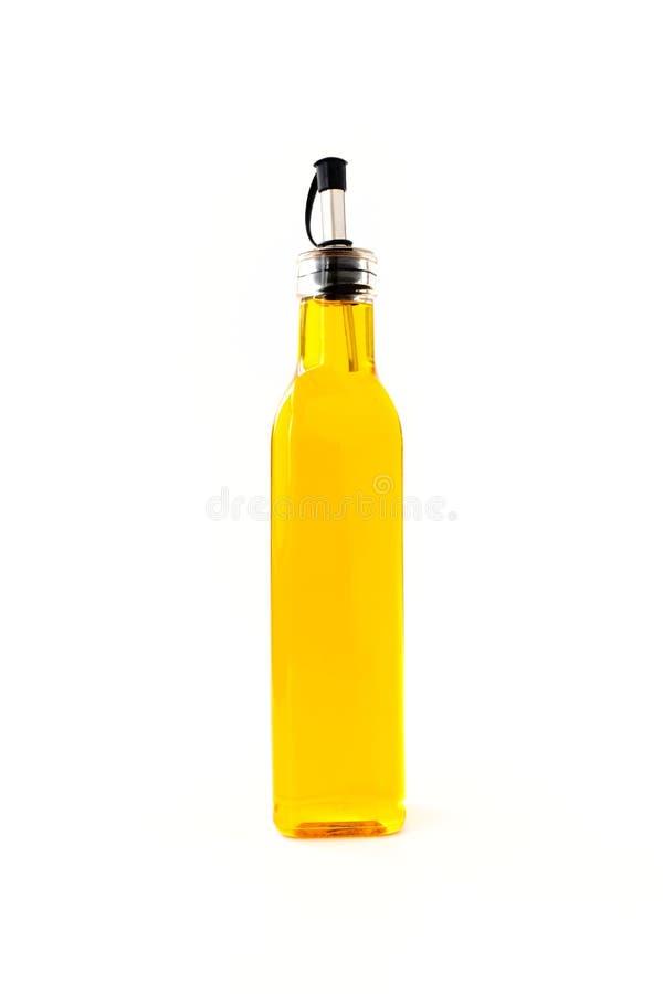 Rapeseed olej w Szklanej butelce na bielu zdjęcie stock