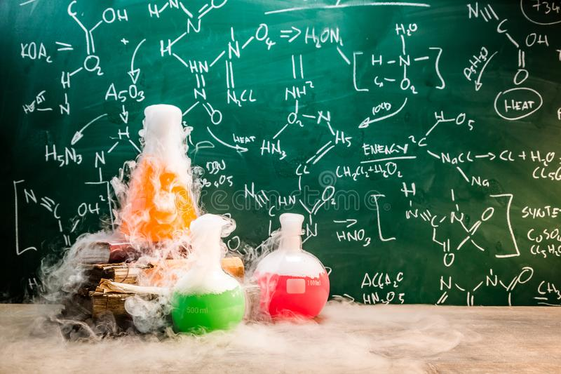 Rapid chemical reaction on chemistry lessons in school. On old wooden table stock photo