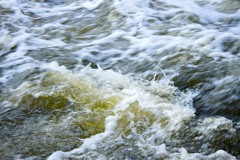 The rapid flow of river water