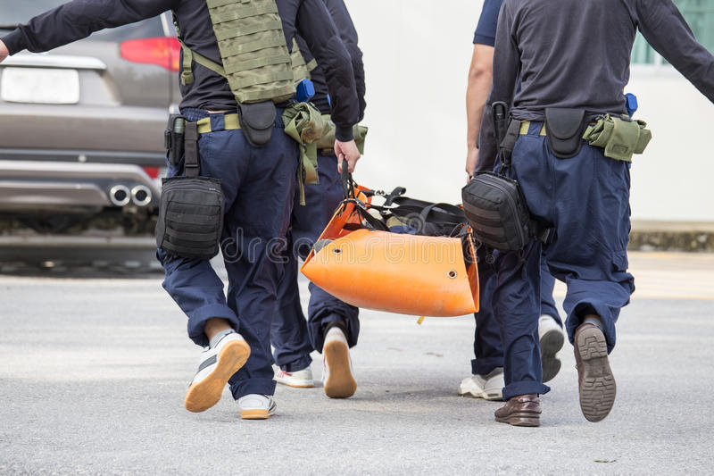 Rapid medical evacuation by vehicle practice of law enforcement. Law enforcement team use light stretcher for medical evacuation to vehicle in training course stock photos
