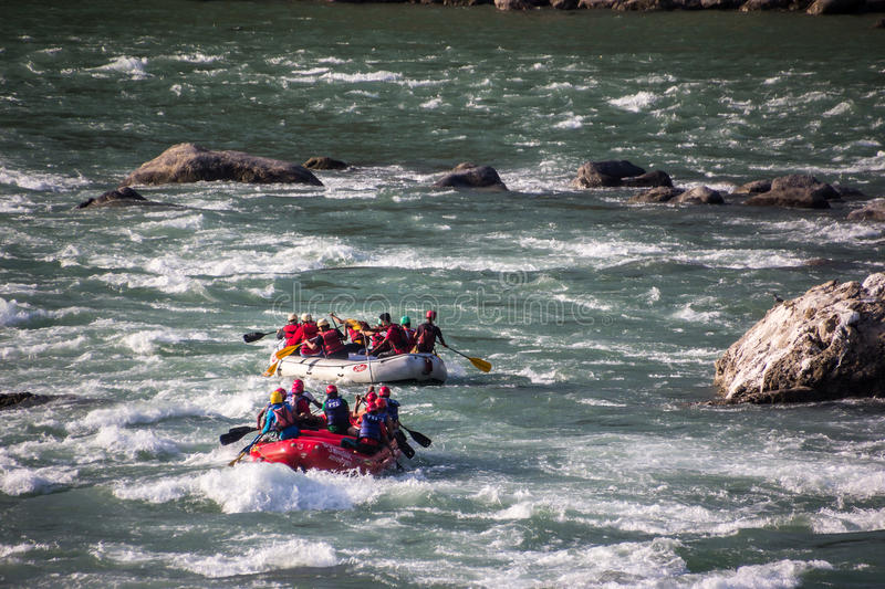 In the rapids of the Ganges. Two dinghies are just crossing the rapids of the Ganges at Rishikesh, India. Unrecognizable persons stock images