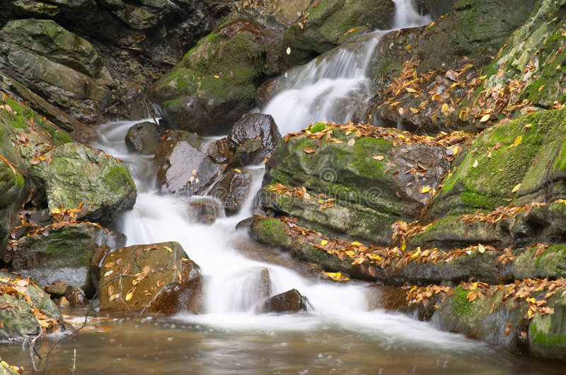 Rapids in a mountain brook stock images