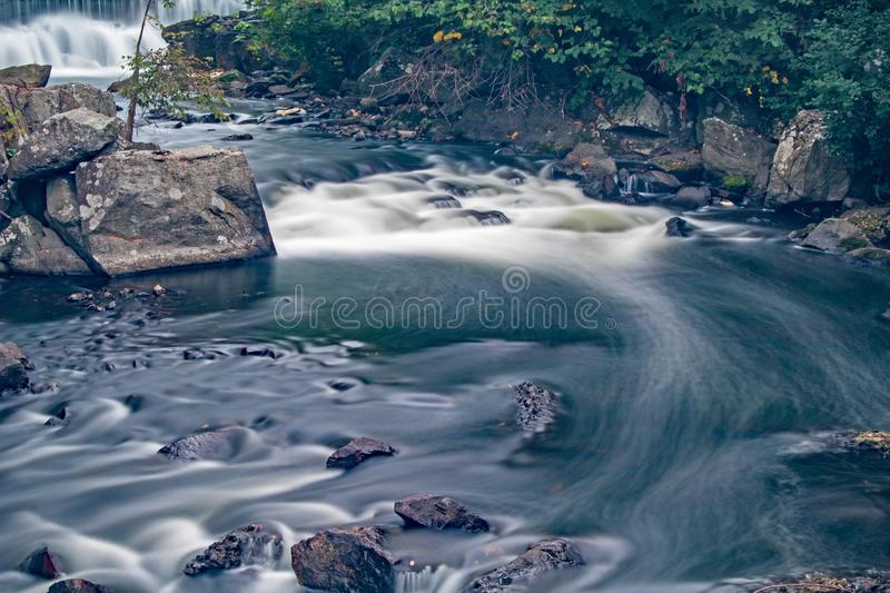 Rapids On The Yamaska River In Granby, Quebec. Long exposure view of rapids on the Yamaska River in Granby, Quebec, Canada, just below the remnants of a mill dam stock photography