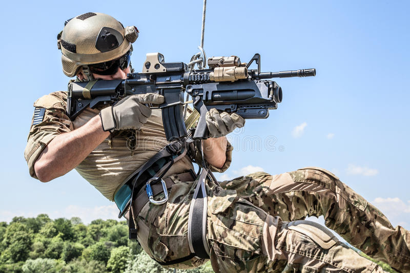 Rappeling with weapons stock images