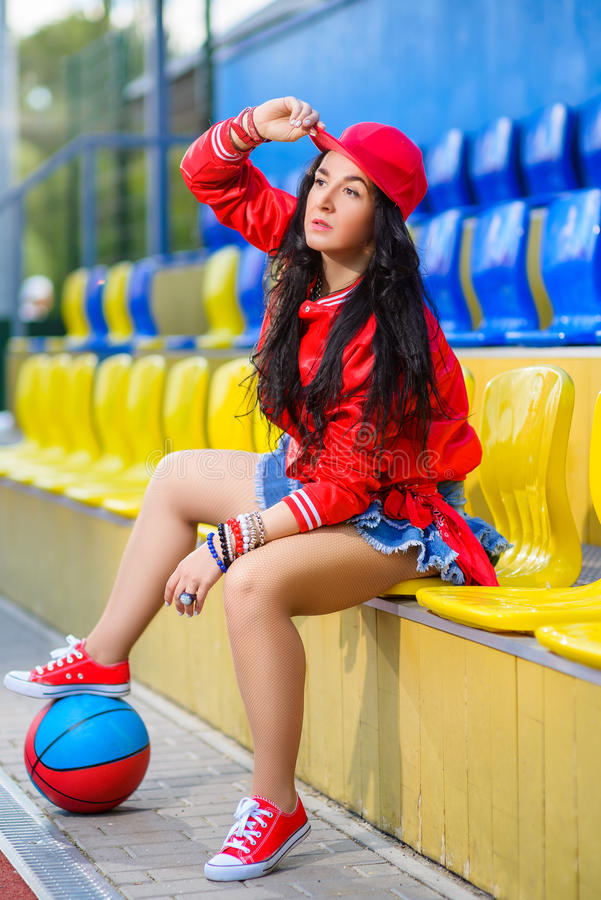 Rapper attitude rap singer hip Hop Dancer. Performing. Stylish woman and little boy posing at basketball court royalty free stock photography