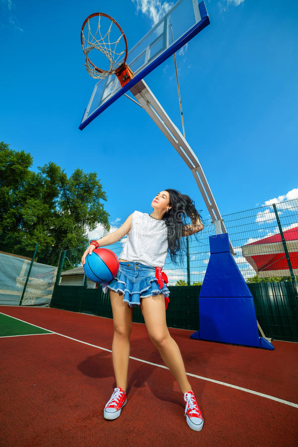 Rapper attitude rap singer hip Hop Dancer. Performing. Stylish woman and little boy posing at basketball court royalty free stock image