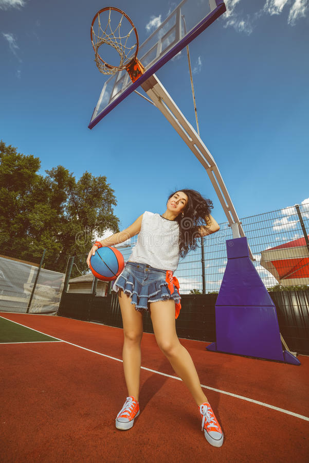 Rapper attitude rap singer hip Hop Dancer. Performing. Stylish woman and little boy posing at basketball court stock photos