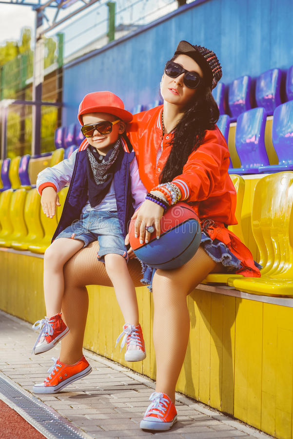 Rapper attitude rap singer hip Hop Dancer. Performing. Stylish women and little boy posing at basketball court stock images