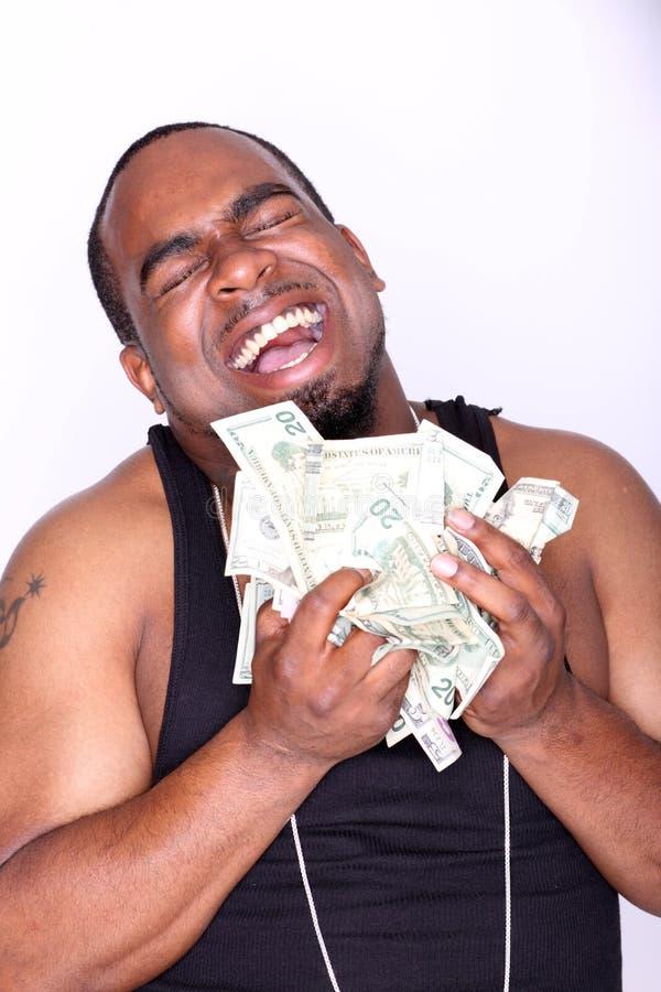 Rapper with cash. Portrait of a happy rapper holding cash stock image