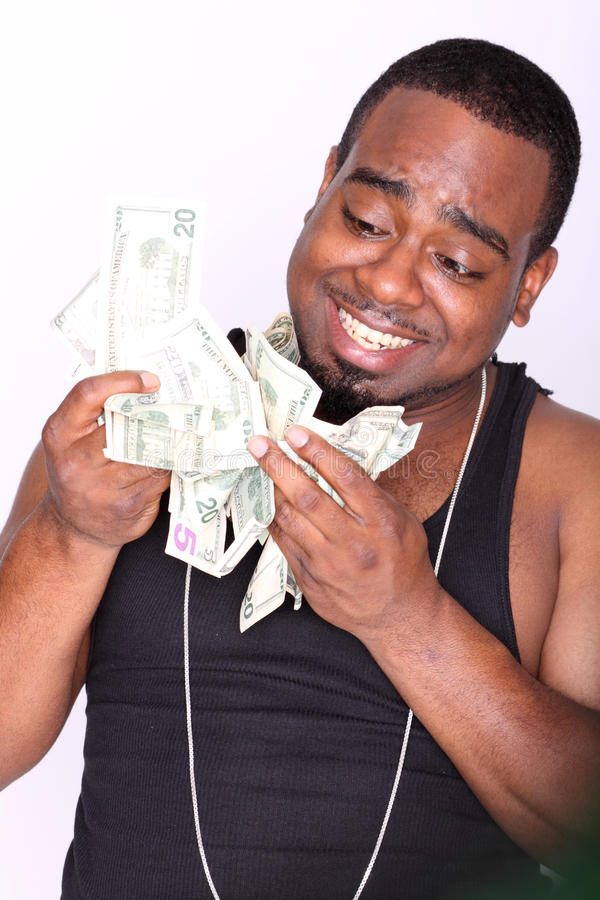 Rapper with cash. Portrait of a happy rapper holding cash royalty free stock photography