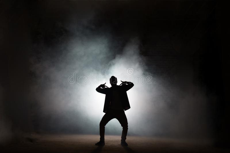 Rapper dancing isolated on black background royalty free stock images
