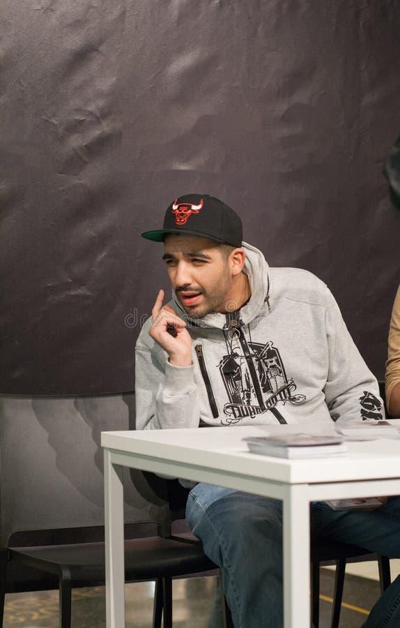 Rapper Fard (Farhad Nazarinejad). WEITERSTADT, GERMANY – NOVEMBER, 2011: Rapper Fard (Farhad Nazarinejad) at a autograph session for fans on November 12 stock photo