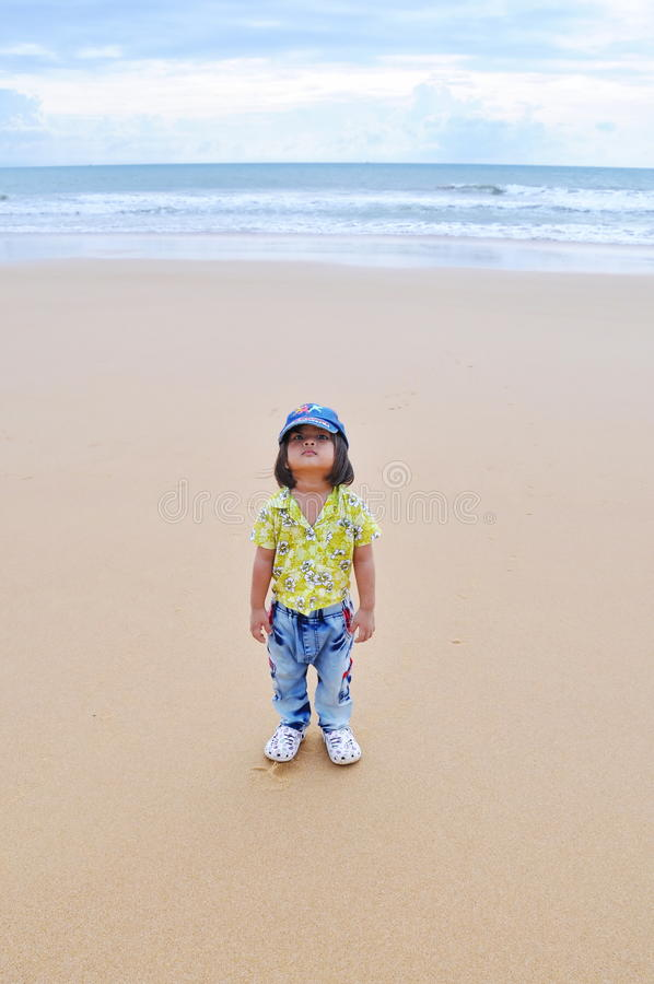 Rapper girl. Post front of sea on the beach stock photography