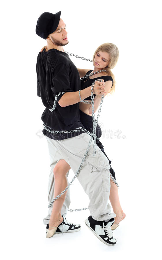 Rapper graceful girl dance twisted with chains. Rapper wearing black t-shirt graceful girl dance twisted with chains isolated on white background stock photos