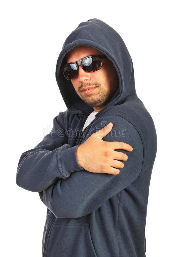 Rapper male posing. Rapper male with hood and sunglasses posing in semi profile isolated on white background stock photos