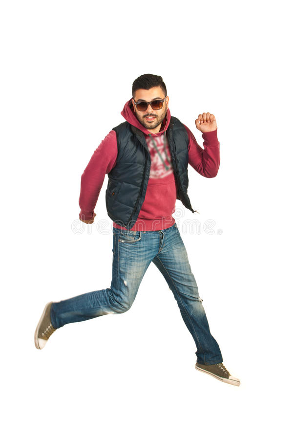 Rapper man jumping in the air. Isolated on white background stock photography