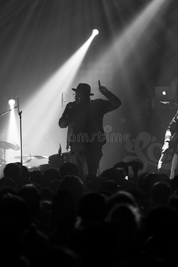Rapper silhouette. Rapper with old school Run DMC style performing during a show in Montreal royalty free stock photo
