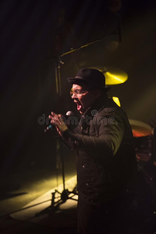 Rapper silhouette. Rapper with old school Run DMC style performing during a show in Montreal stock image