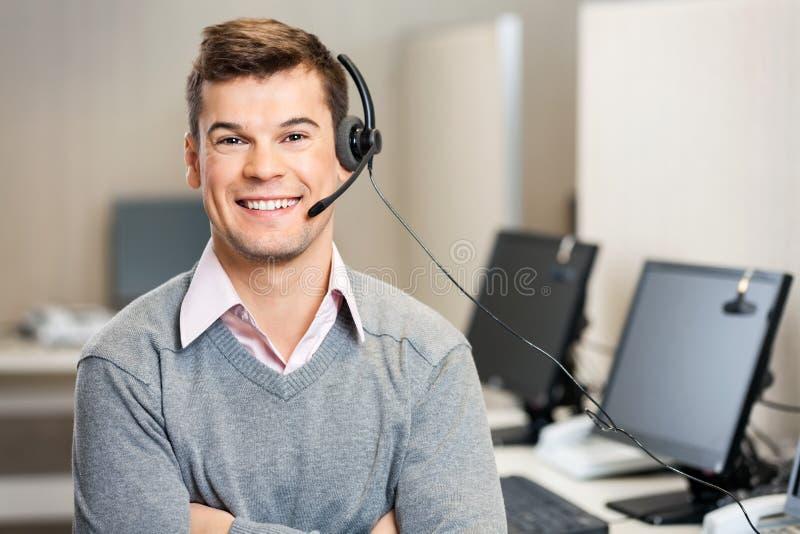 Rappresentante With Headset In di servizio di assistenza al cliente fotografia stock