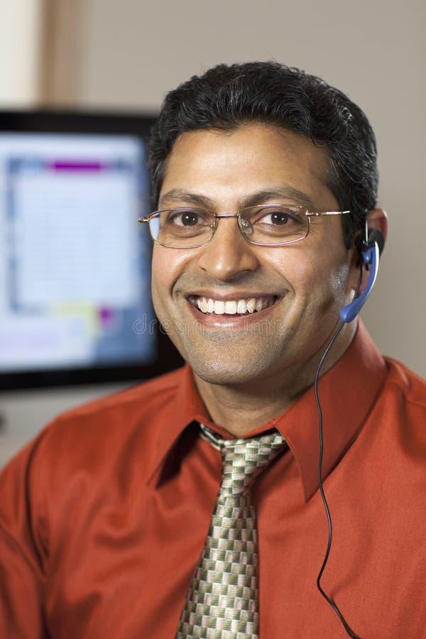 Rappresentante sorridente di servizio di assistenza al cliente immagine stock libera da diritti