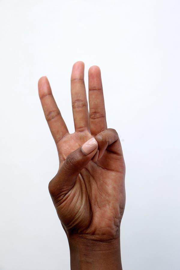 Rappresentazione indiana numero tre della mano dell'africano nero fotografia stock
