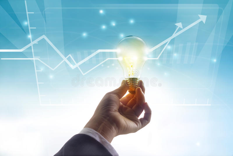 Rappresenti graficamente l'idea di passato di statistiche più su, concetto di simbolo della lampadina fotografia stock